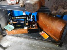 A No.99 Singer sewing machine in very good condition with case, book, key etc.