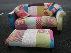 A good quality multi coloured fabric sofa with matching foot stool.