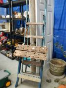 A folding work bench and a 5 tread step ladder.