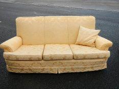 A brocade 3 seat sofa.