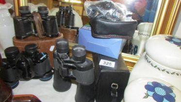 Four pairs of binoculars.