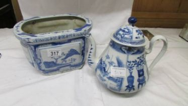 A blue and white teapot together with a blue and white planter.