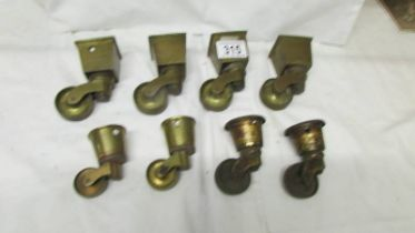 A set of four brass furniture caster for square legs and 4 others.