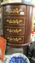 A superb quality mahogany inlaid four drawer inlaid chest.