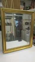 A bevel edged gilt framed mirror, 60 x 50 cm (Collect only).