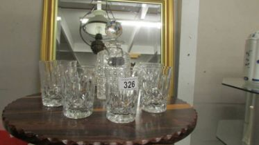 A cut glass decanter and six whisky tumblers.