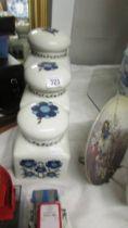 A set of three Taunton Vale pottery storage jars.