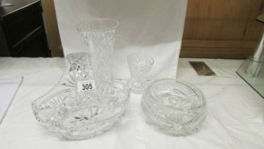 A cut glass basket, bowl and two vases.