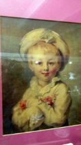 A framed and glazed portrait of a child.