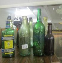 A mixed lot of old bottles including football related.