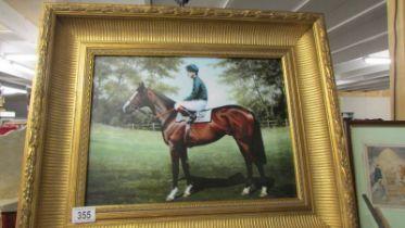 A gilt framed print of a racehorse.