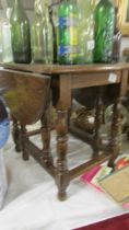 A good quality small oak drop side table.