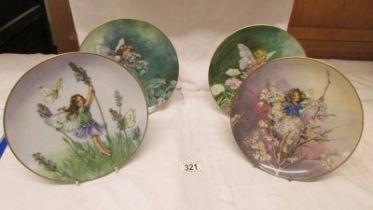 Four Villeroy and Boch fairy plates.