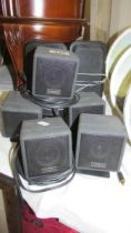A pair of speakers and five small speakers.