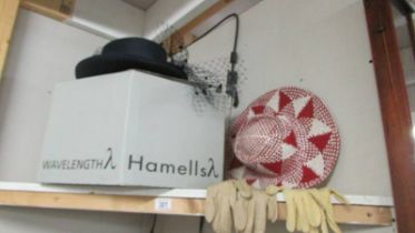 A vintage hat box, hats and gloves.