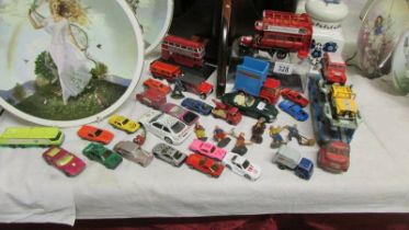 A mixed lot of play worn die cast cars.
