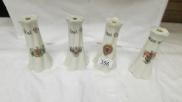 Four crested hat pin stands.