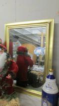 A gilt framed bevel edged mirror, 85 x 65 cm,