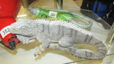 A ceramic bearded dragon and another bearded dragon.