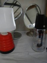 Two chrome shaving mirrors, a table lamp etc.
