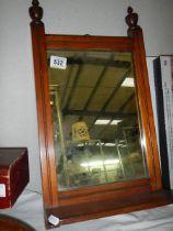 A mahogany framed mirror.