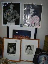 A quantity of celebrity photographs including some signed.
