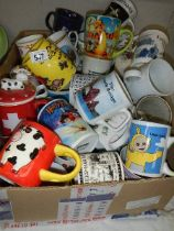 A box of assorted mugs.
