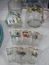 A set of six shot glasses and two others all decorated with vintage cars.