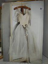 A print on canvas depicting a wedding gown.
