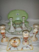 Two ceramic dressing table sets.