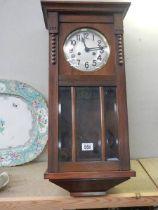 A 1930's oak wall clock.