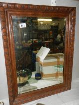 An oak framed mirror.