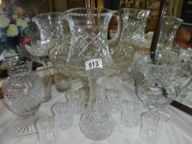 A mixed lot of cut and crystal glass including jugs, vases etc.