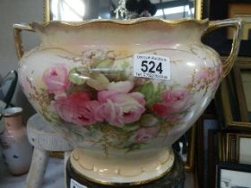 A Victorian rose decorated jardiniere.