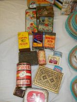 A mixed lot of old collector's tins.