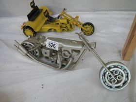 Two vintage style motor cycles constructed from nuts and bolts.