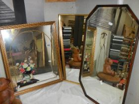 Three framed mirrors including one bevel edged example.