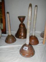 Four copper washing dollies.