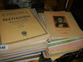 A quantity of music books and sheet music.