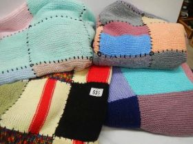 Four knitted blankets.