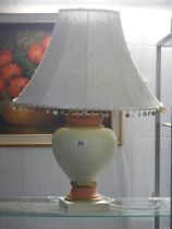 A ceramic table lamp with shade.