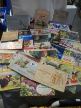 A good lot of cigarette and tea cards in albums.