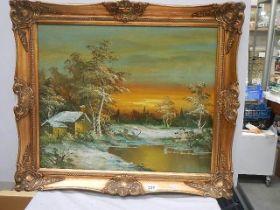A signed gilt framed winter scene.