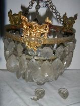 A small old chandelier featuring cherubs. ****Condition report**** Missing droppers.
