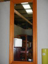 A pine framed mirror.