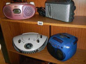 Four portable radio's.