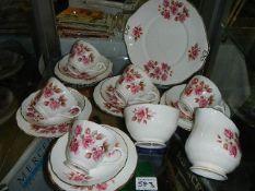 A part Duchess rose decorated tea set,