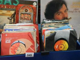 A quantity of LP and 45 rpm records.