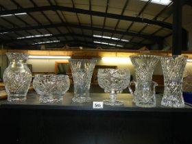 Four cut glass vases and two bowls.