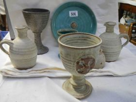 A mixed lot of studio pottery including jugs, goblets etc.